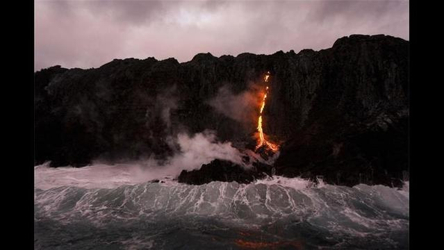 Lava Flows to the Ocean in Hawaii, Creating Rare Natural Show
