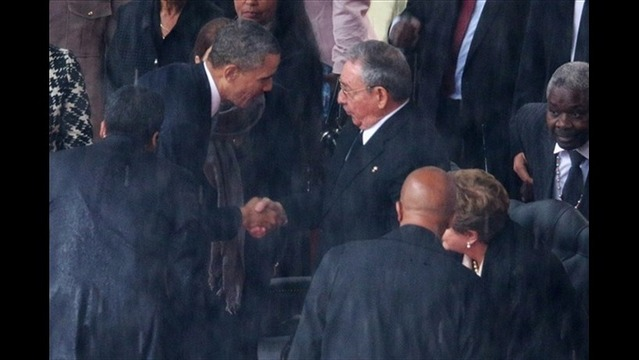 President Obama Greets Cuban President Raul Castro at Mandela Memorial Service