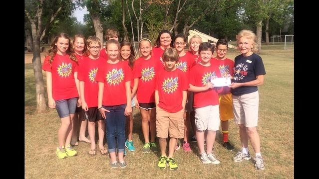 West Foundation Student Council Presents Camp Fire with $1000 Check